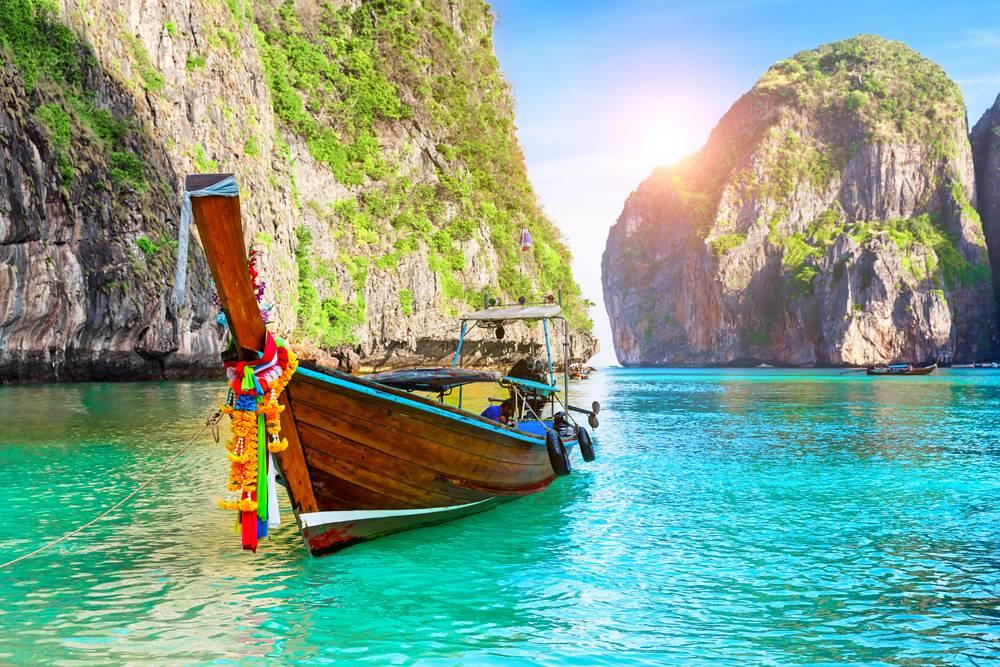 Maya Bay lagoon at Ko Phi Phi Leh Island with Thai traditional longtail boat, Thailand