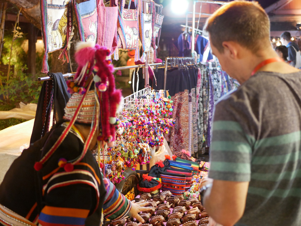 Negotiating the price of hill tribe souvenirs in Chiang Mai, Thailand