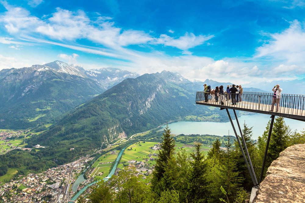 People standing on the observation deck in Interlaken on a beautiful summer day, Switzerland