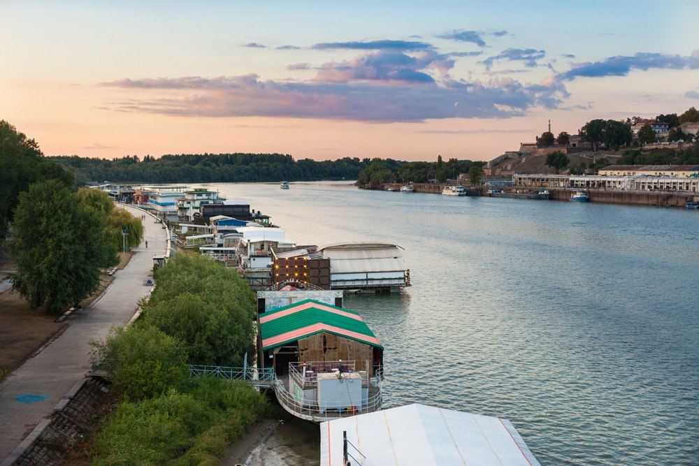 Splav (river barge) night clubs on the Sava at sunset, Belgrade, Serbia