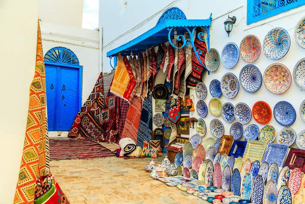 Souvenir earthenware and carpets in a Tunisian market, Sidi Bou Said, Tunisia
