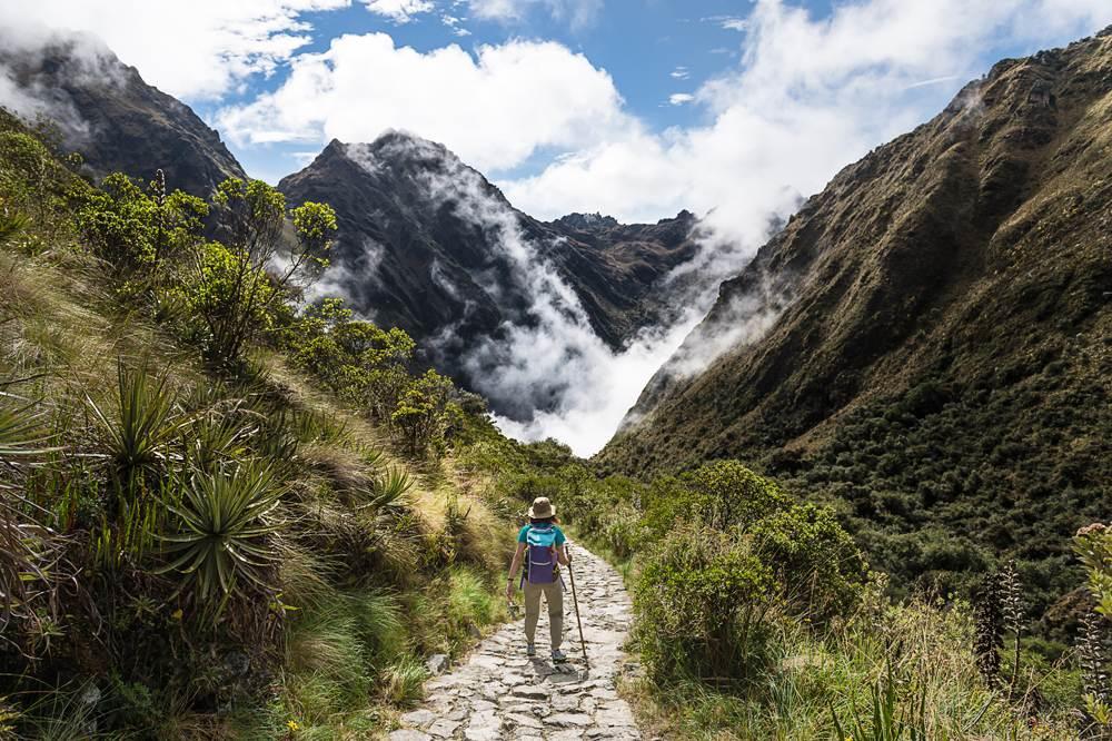 Woman walking on the Inca Trail, Machu Picchu, Peru