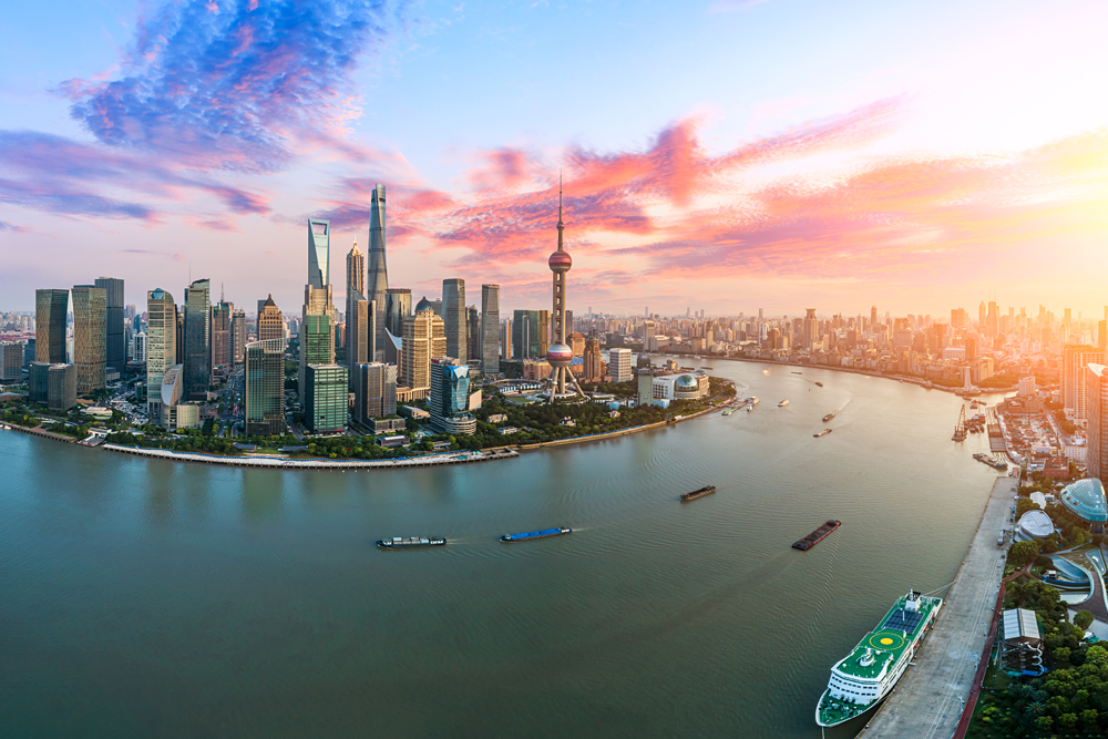 Aerial view of Shanghai skyline at sunset, China