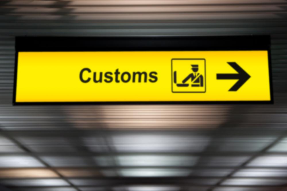 Airport customs sign at airport in international terminal
