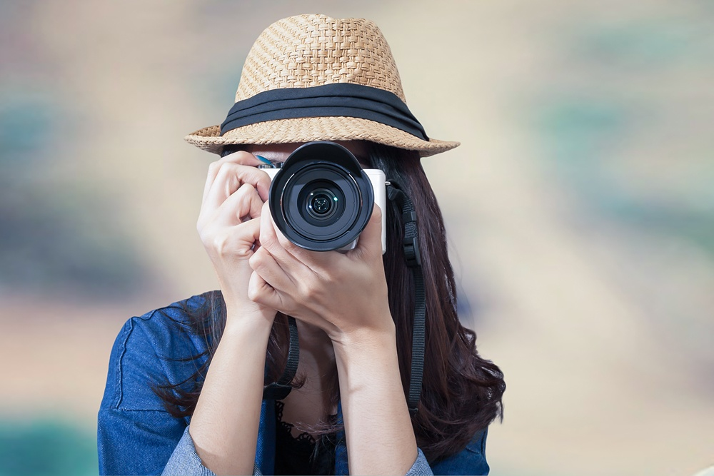 Female traveller taking a photograph