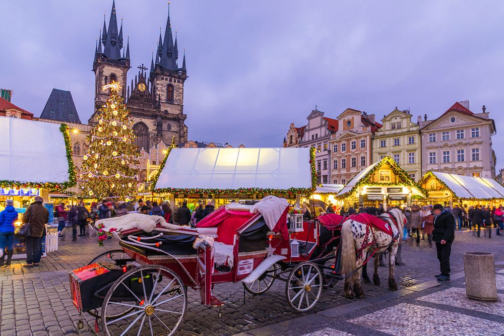 Horse and carriage at Christmas market in Old Town Square, Prague, Czech Republic