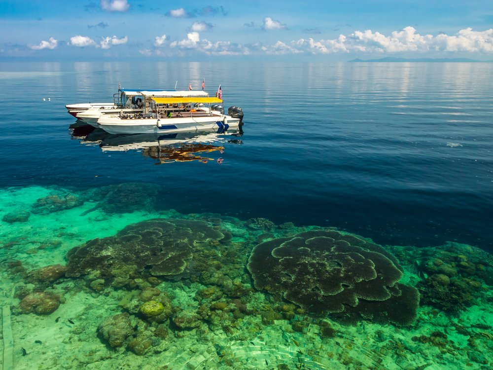 Sipadan Island dive boats and view of coral, Borneo, Malaysia