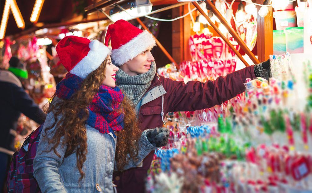 Young couple shopping at Christmas market in Germany