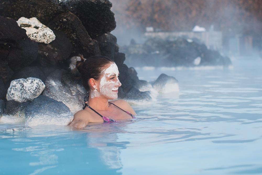 Enjoying the Blue Lagoon warm waters with a healing silica mud mask, Iceland