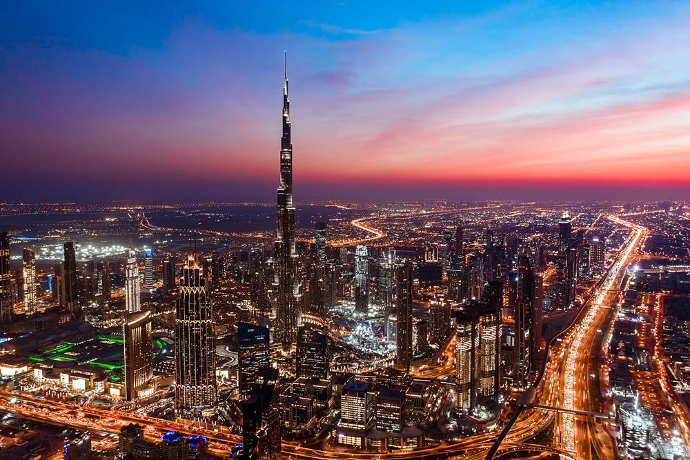 Aerial view of Dubai skyline and Burj Khalifa during a colourful sunset, United Arab Emirates (UAE)