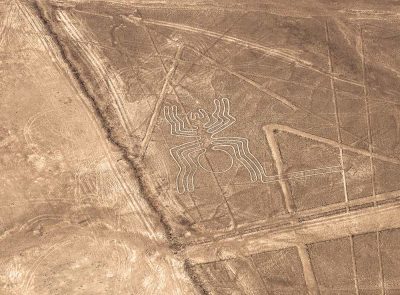 Aerial view of a spider geoglyph drawing in Nazca Lines, Peru