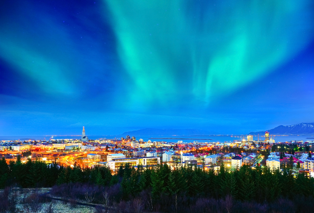 View of the Northern Lights from the city centre in Reykjavik, Iceland
