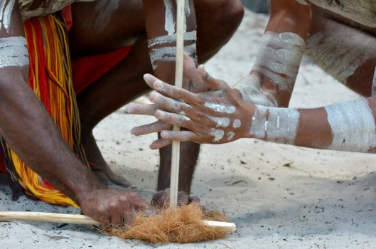 Aboriginal warriors men demonstrate fire making craft