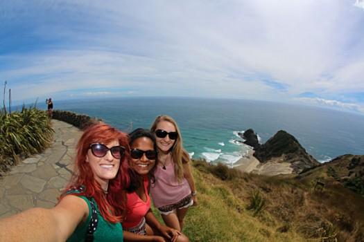 Kiwi-Experience-Friends-Selfie-at-Cape-Reinga-North-Island-New-Zealand