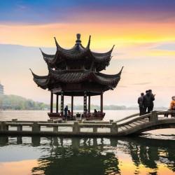 Beautiful West Lake Scenery at Dusk in Hangzhou, China and Year of Monkey Symbol