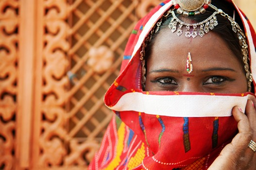 Indian Woman Covering Half Face With Sari, India