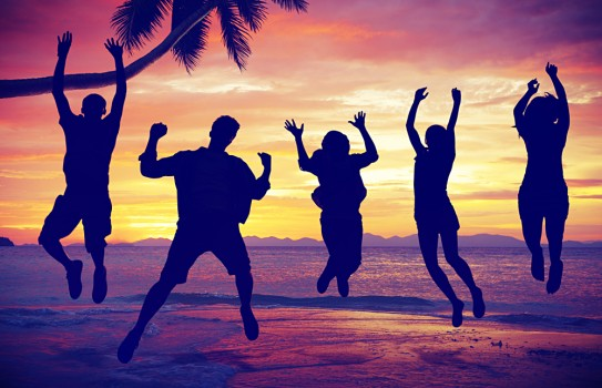 Silhouettes of People Jumping by the Sea