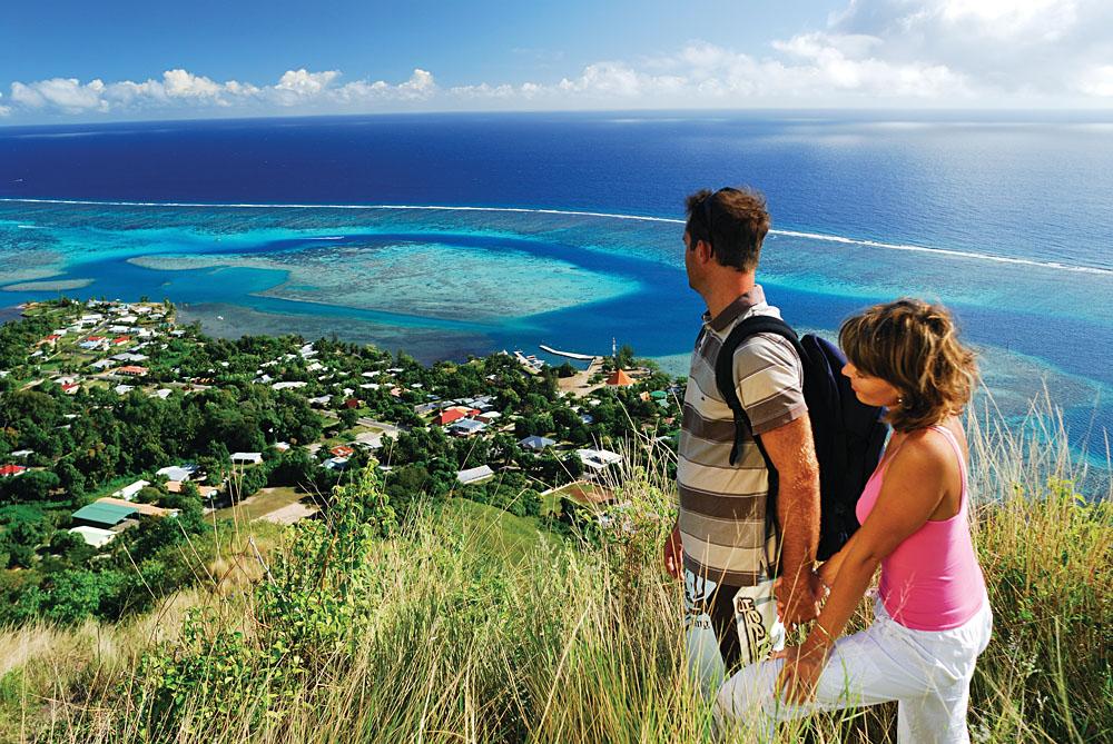 Couple Enjoying Hike and Beautiful Scenery of Moorea, Tahiti (French Polynesia)