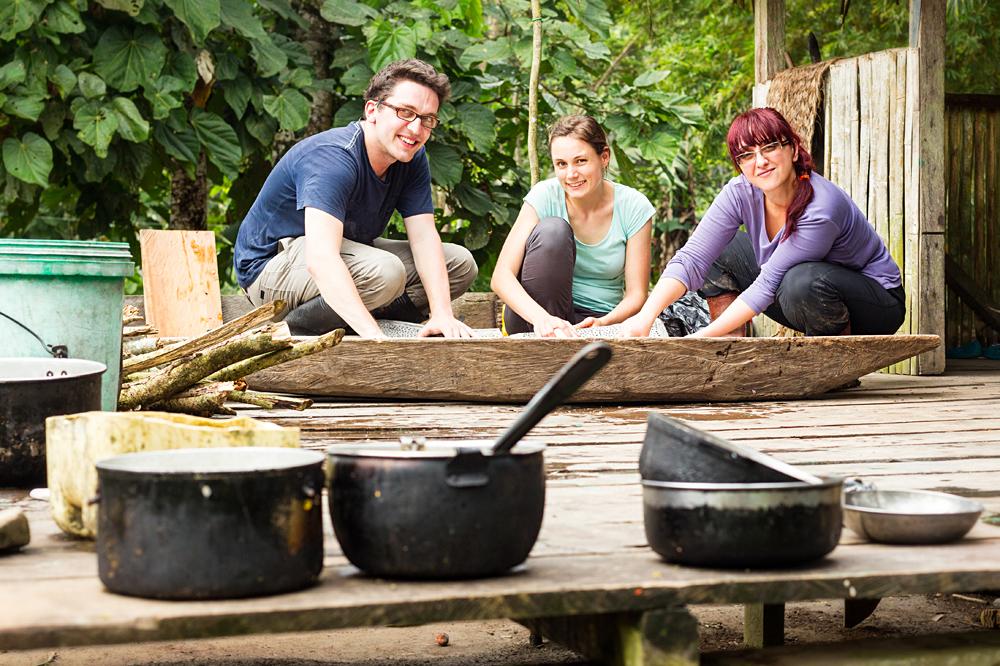 Group of Tourists Preparing Cassava Pie in Ecuador