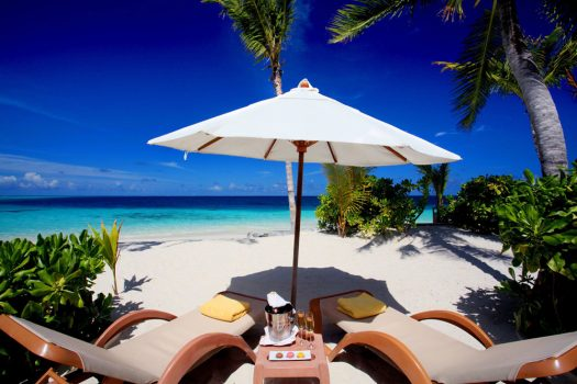 Relaxing on the beach sipping some bubbly at Centara Ras Fushi